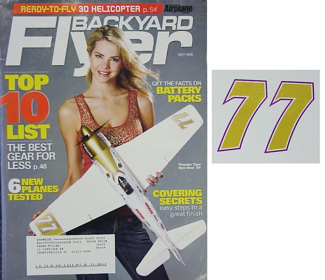 "Photo: Magazine cover with ""77"" reproduced from wingtip"