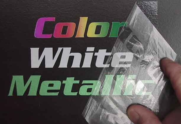 Photo: Color, White and Metallic text on black background