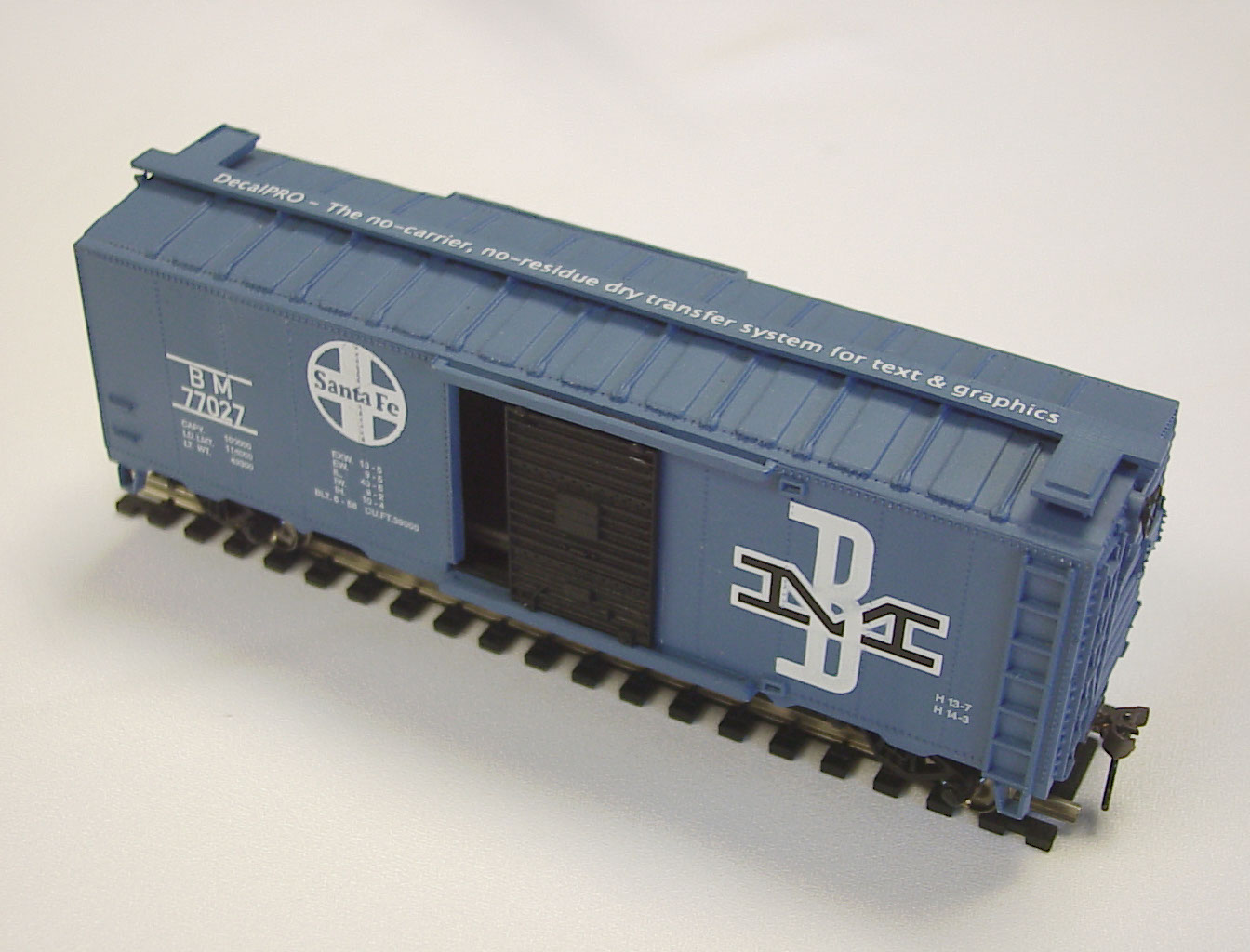 Photo: Text and graphics put on a plastic corrugated railroad car